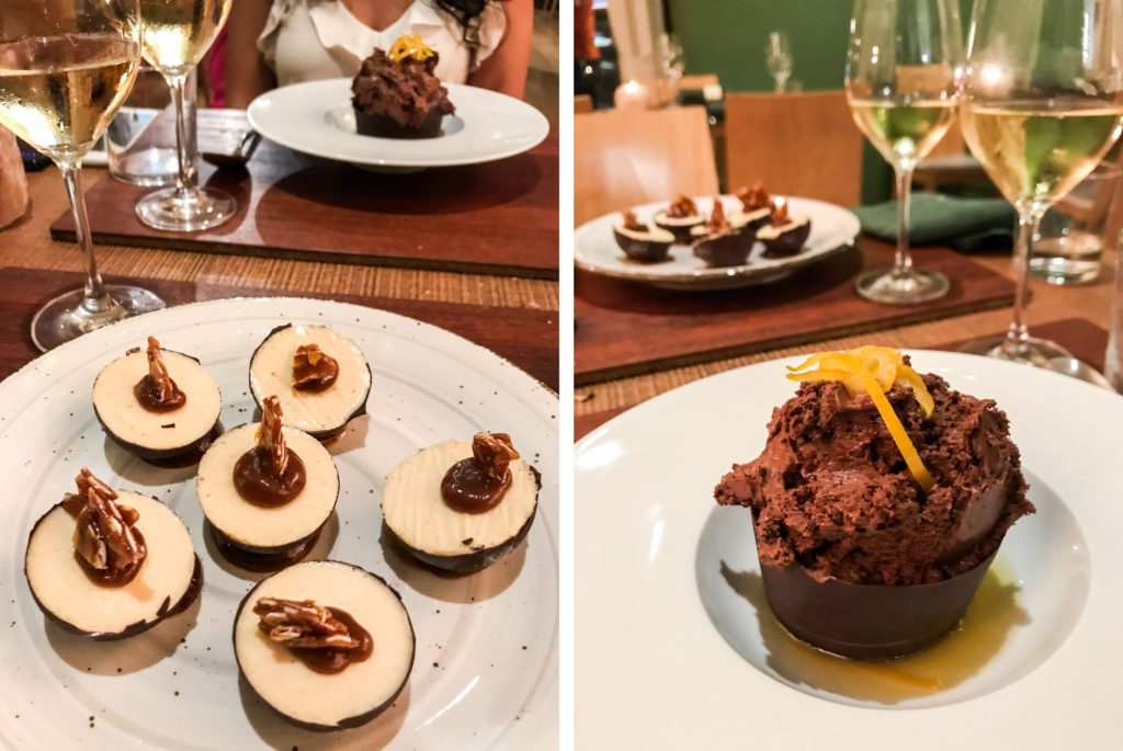 Semifreddo alle mandorle glassato al cioccolato con salsa mou e Mousse al cioccolato amaro con zuppetta di arancia di Bioesserì.